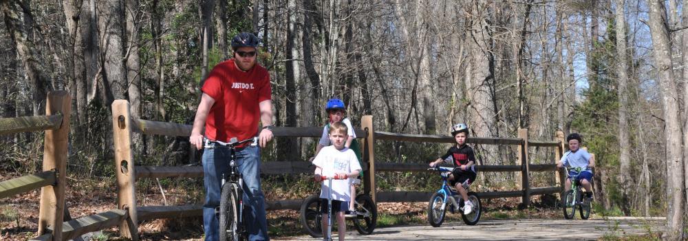 Family riding bikes on greenway