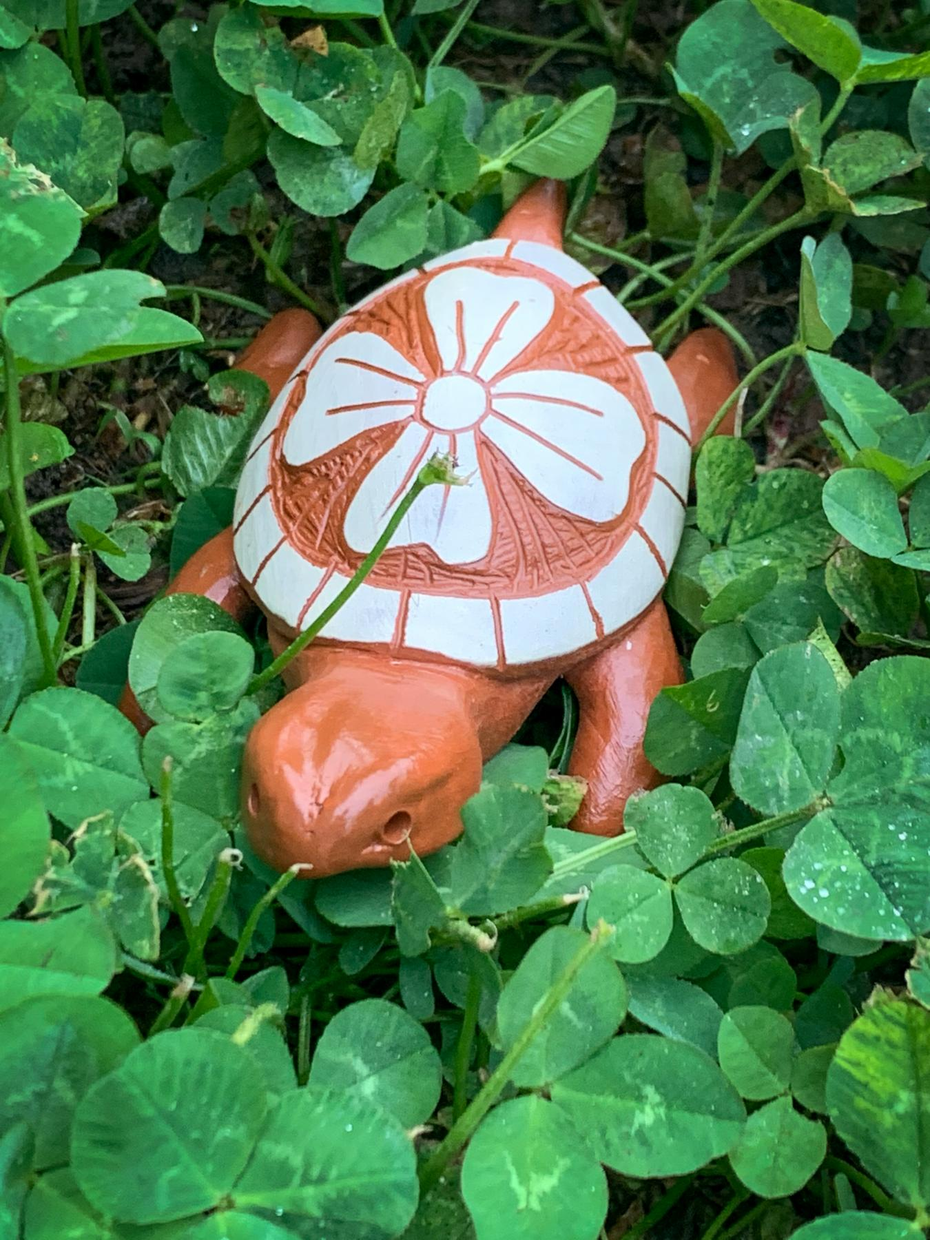 clay turtle with dogwood leaf design