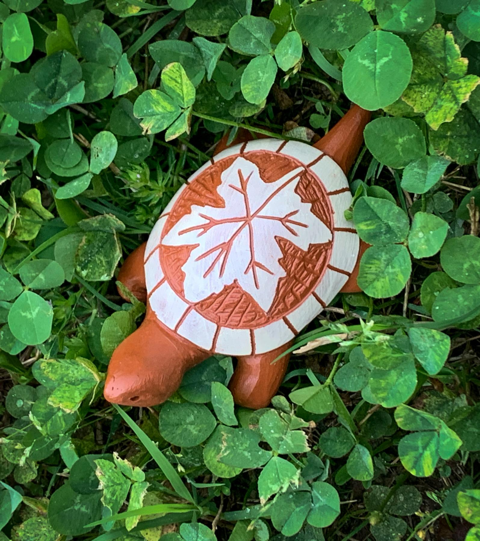 clay turtle with maple leaf design