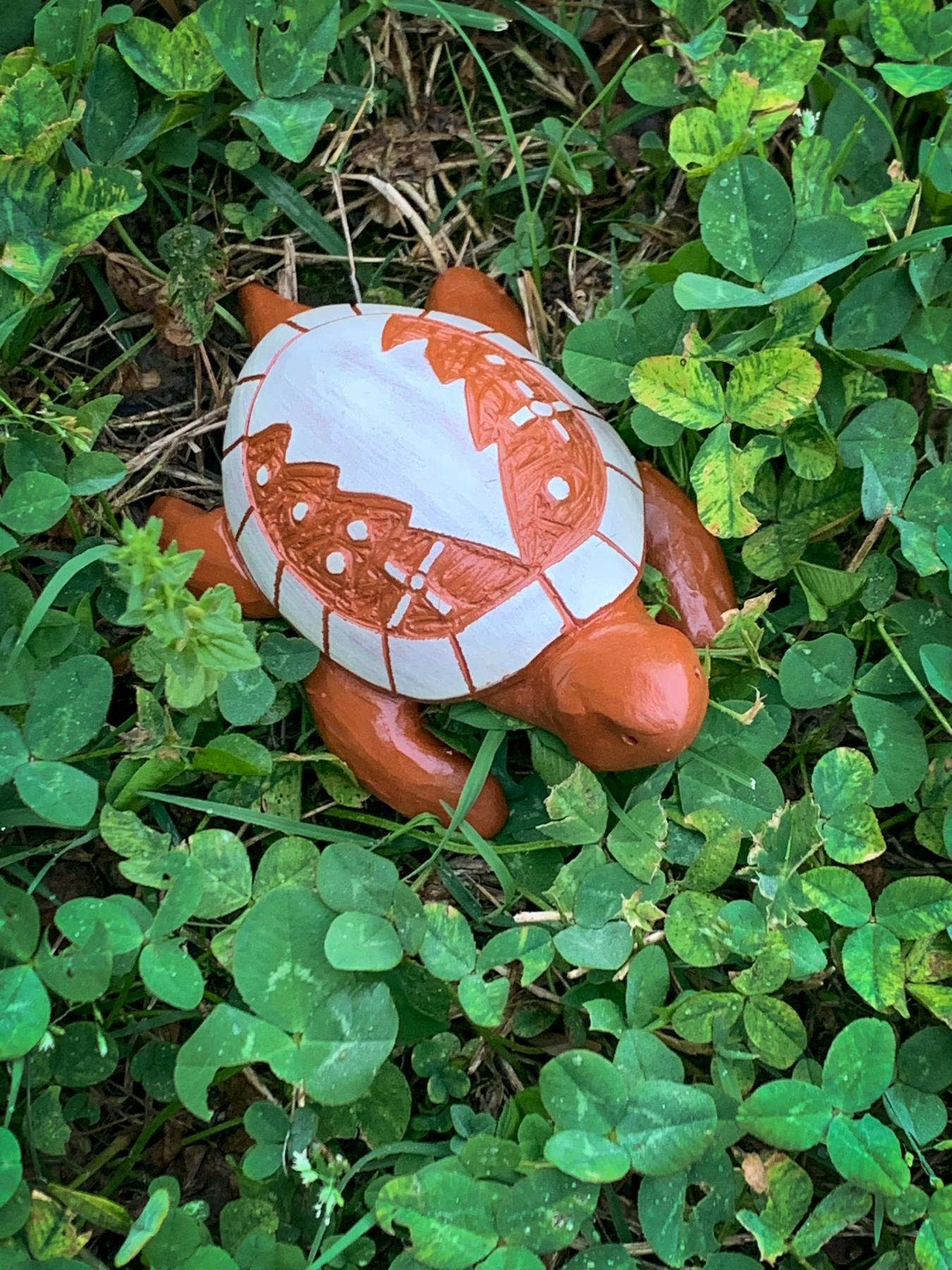 clay turtle with cedar tree design